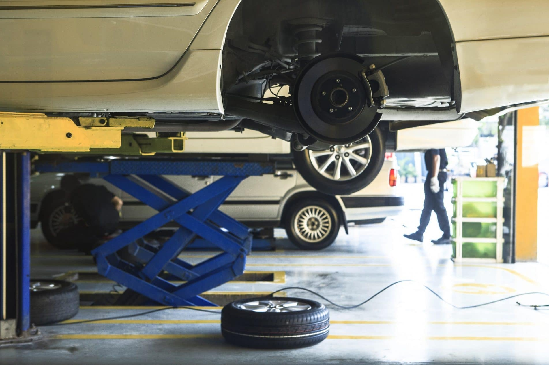 Car Wheel Suspension And Brake System Maintenance In Auto Service